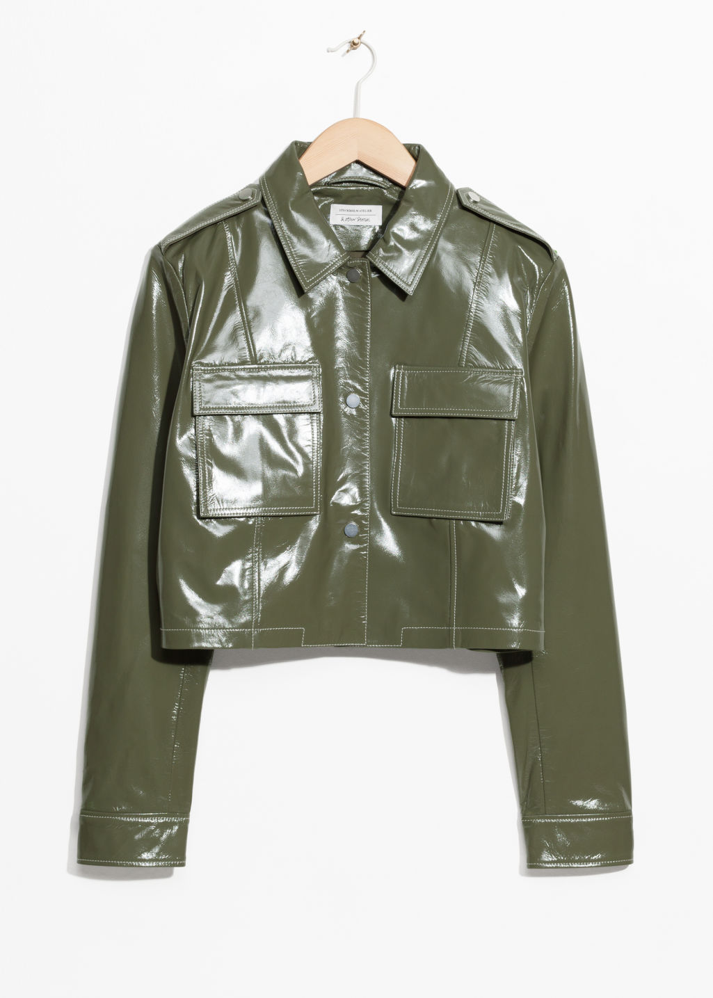 Front image of Stories patent leather utilitarian jacket in green