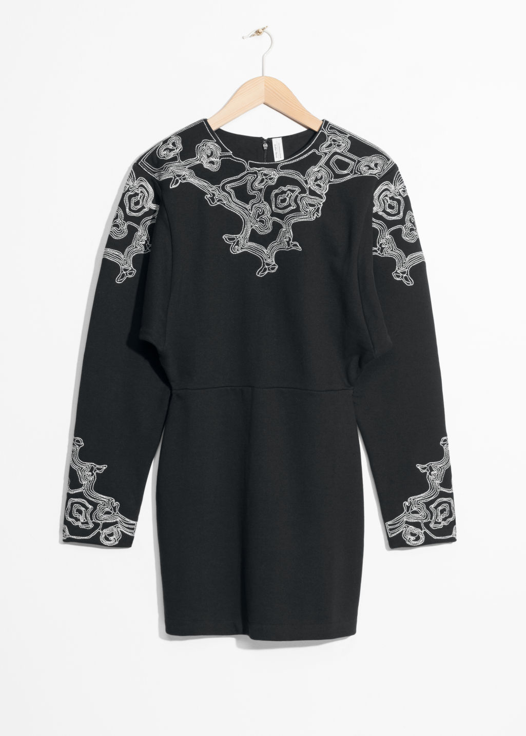 Front image of Stories embroidered mini dress in black