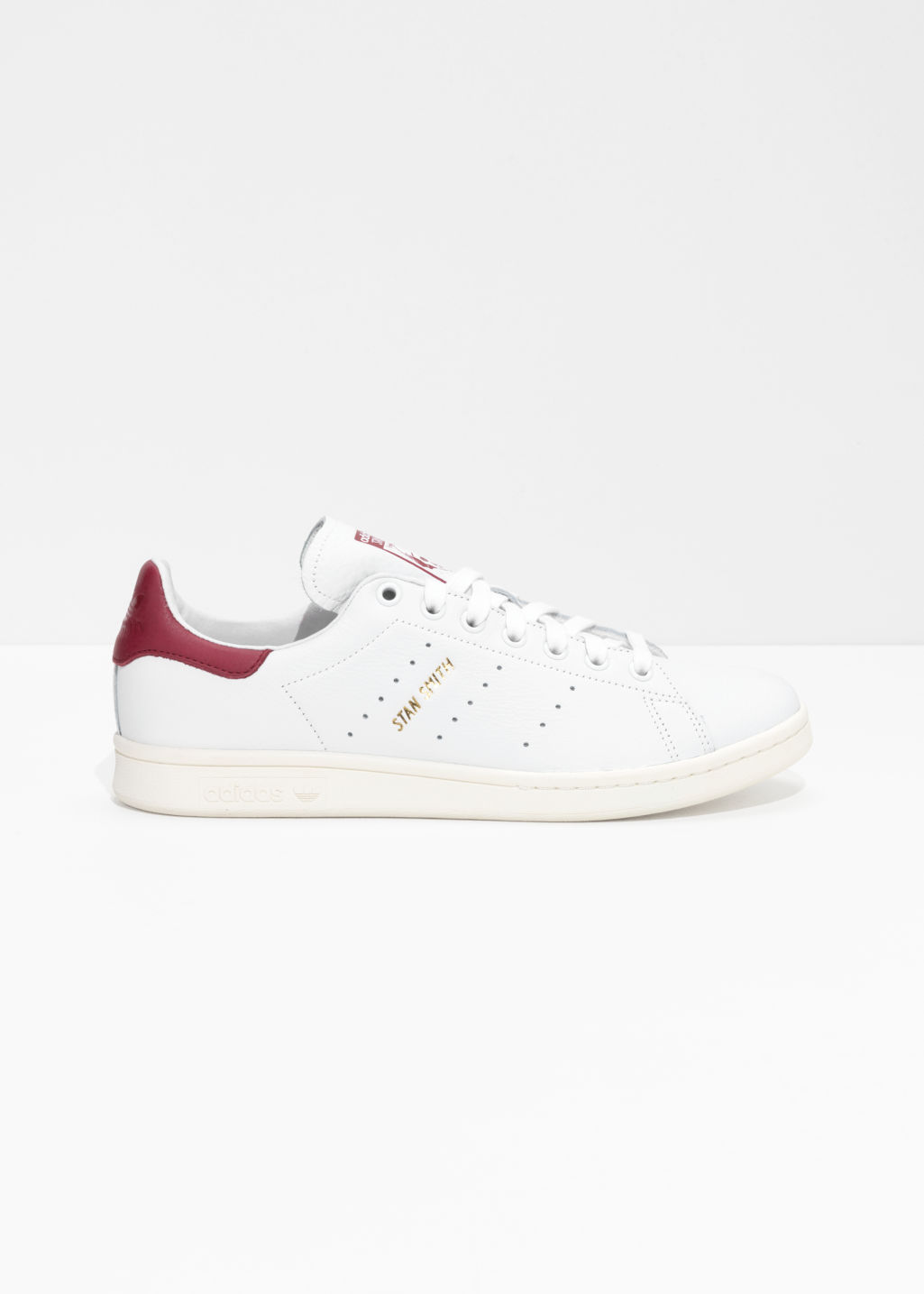 Front image of Stories adidas stan smith sneakers in white