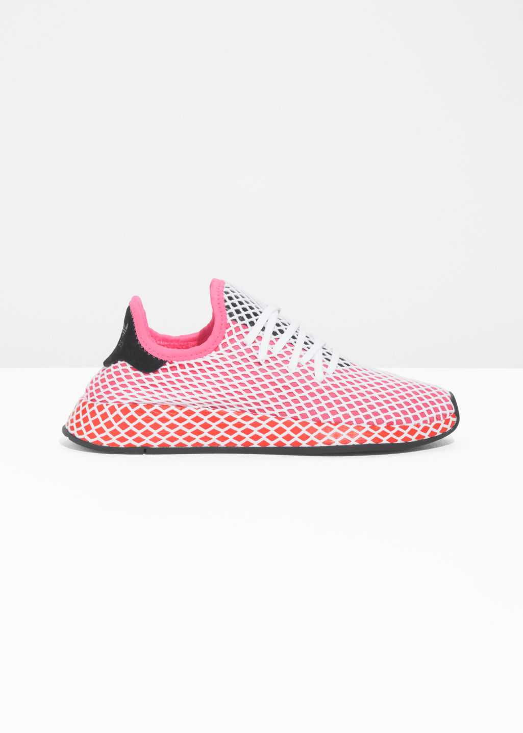 Front image of Stories adidas deerupt runner in pink