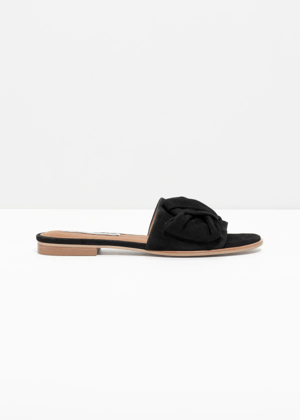 Front image of Stories knotted suede slip ons in black
