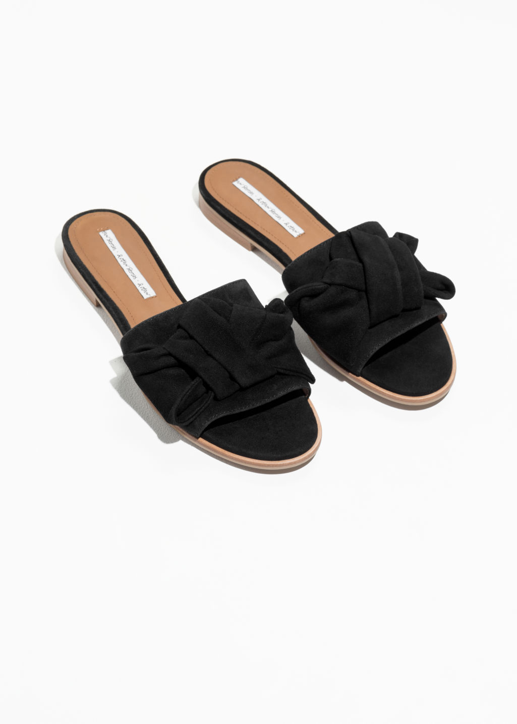 Back image of Stories knotted suede slip ons in black