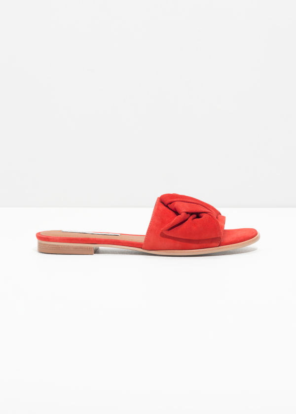 Front image of Stories knotted suede slip ons in red