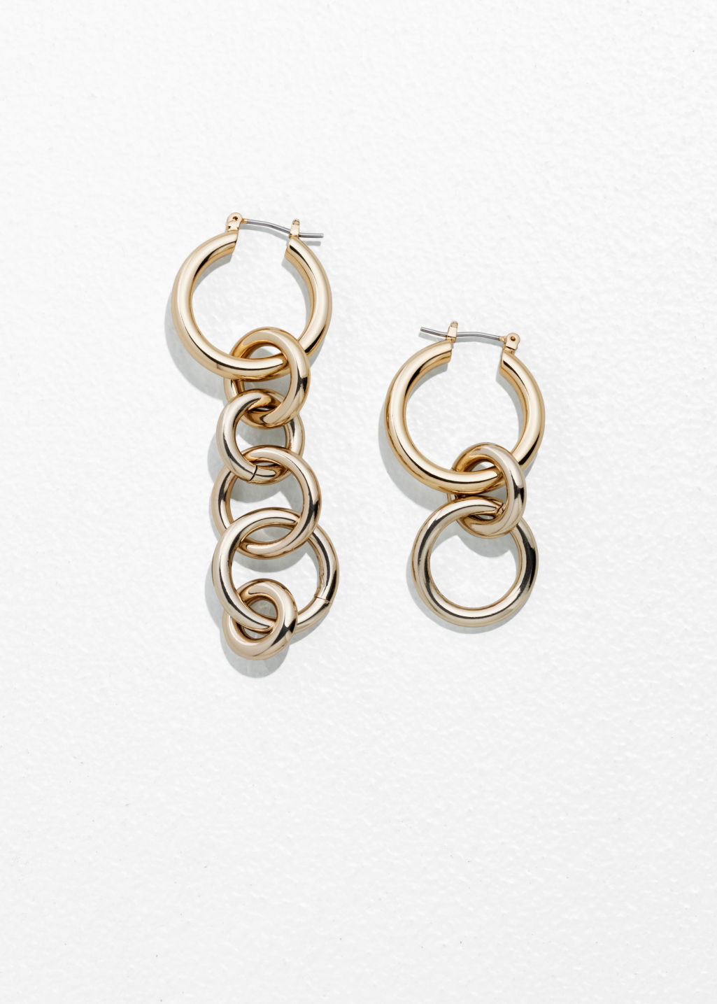 Front image of Stories asymmetric circle link earrings in gold