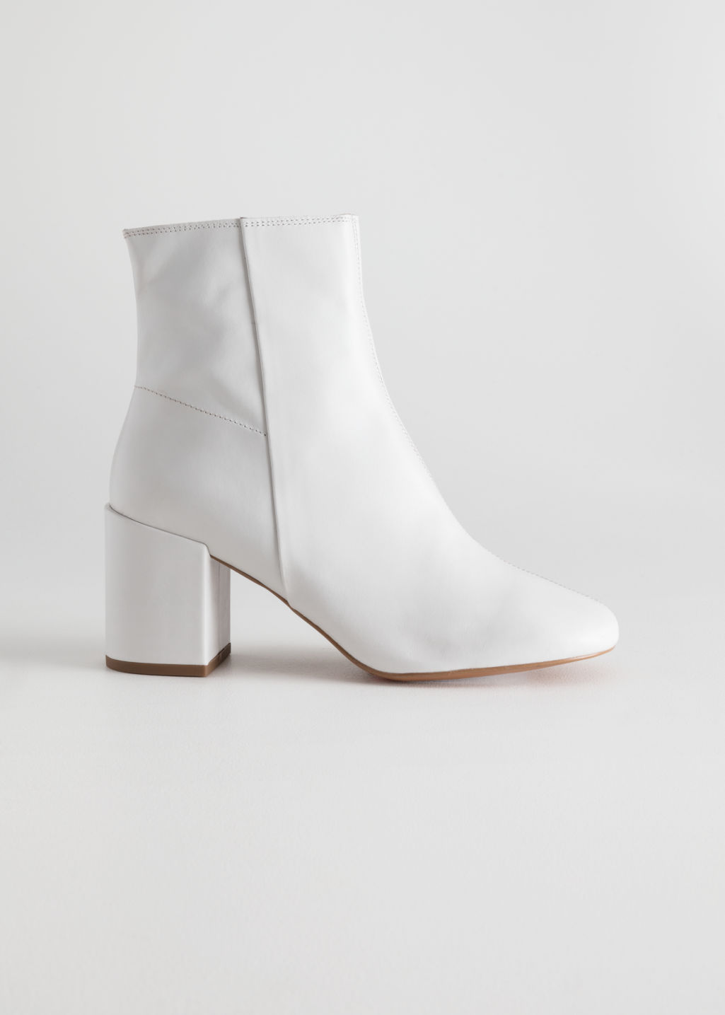 Front image of Stories leather ankle boots  in white