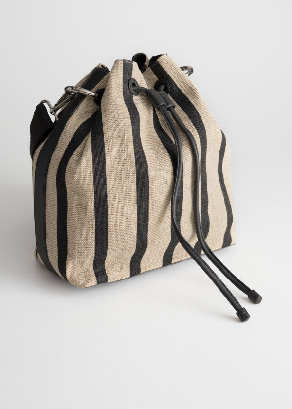 Front image of Stories striped bucket bag in beige