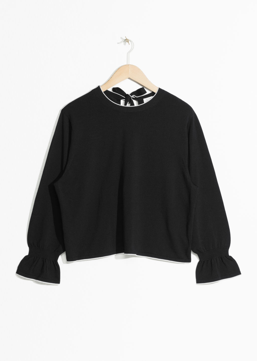Front image of Stories trumpet sleeve blouse in black