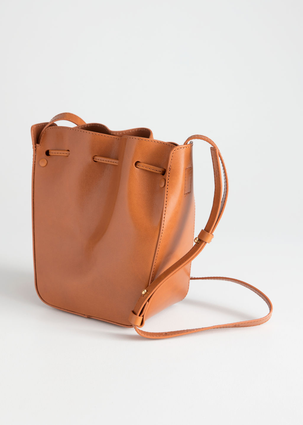 Back image of Stories drawstring leather bucket bag in beige