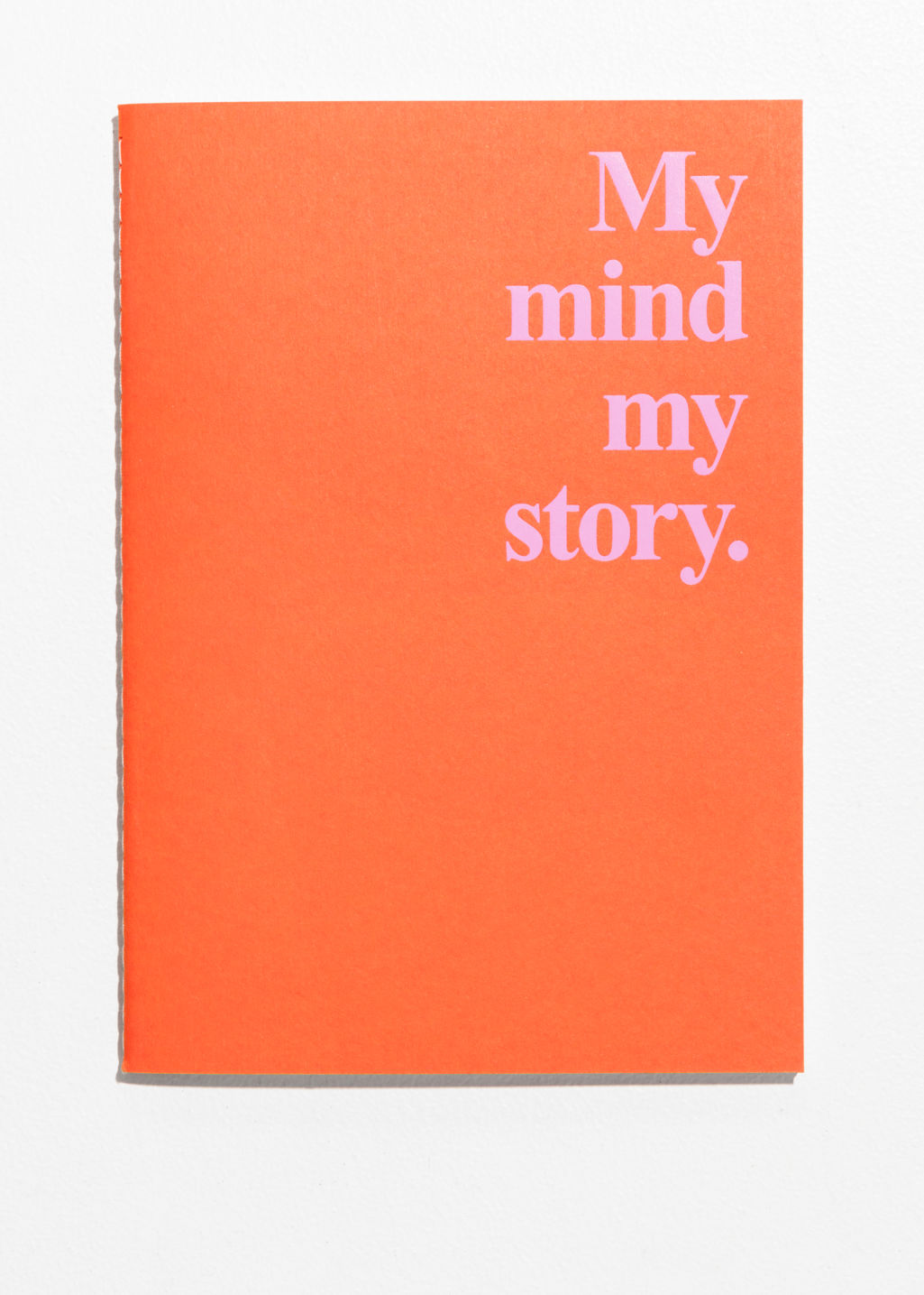 Back image of Stories a5 notebook  in orange