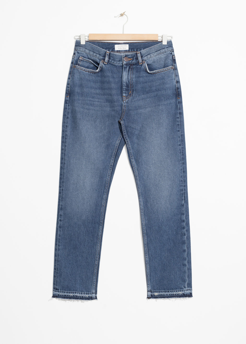 Front image of Stories raw edge slim jeans in blue