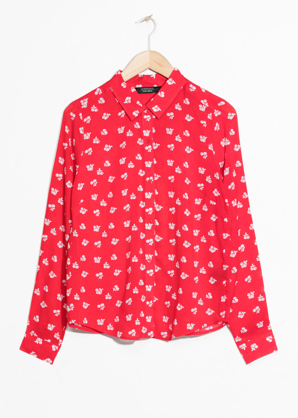 Front image of Stories cherry print button down in red