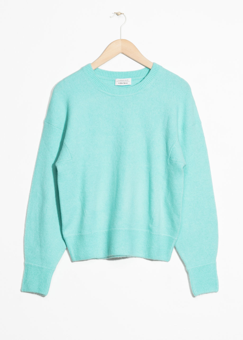 Front image of Stories crewneck sweater in turquoise