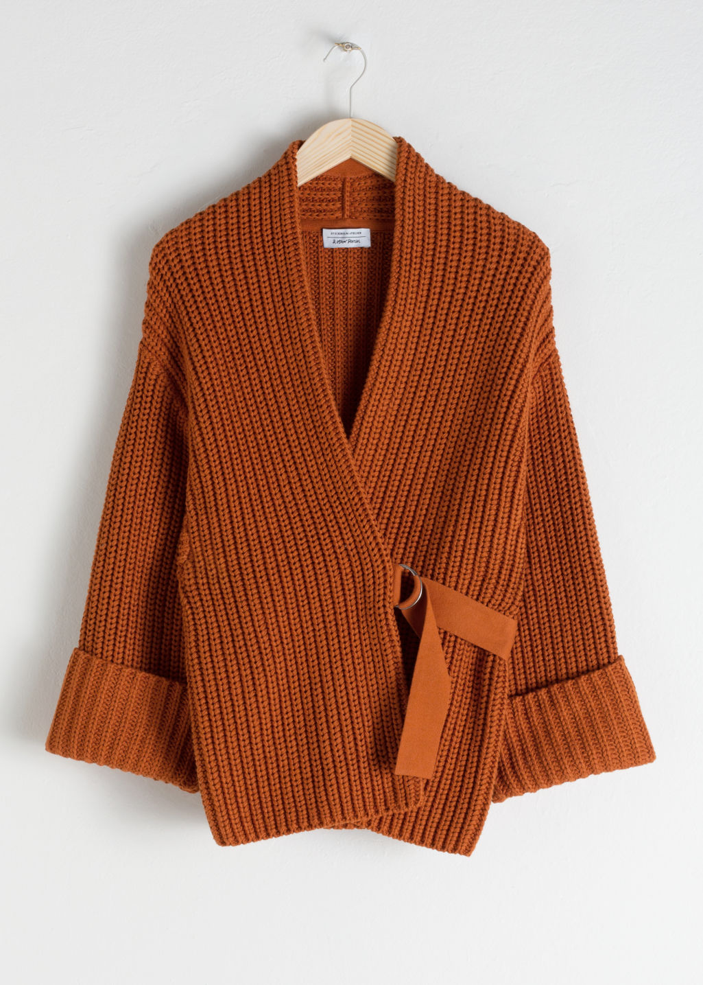 Front image of Stories belted cardigan in orange