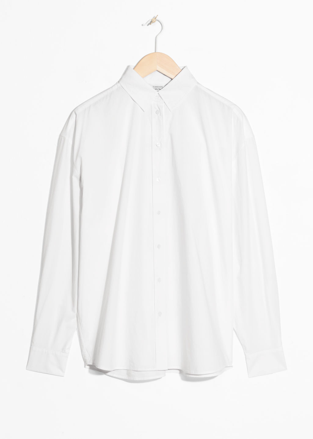 Front image of Stories oversized crisp button down in white