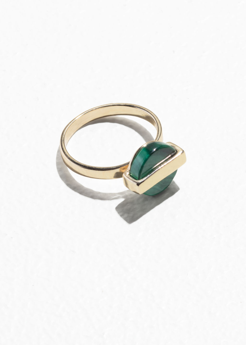 Front image of Stories circle stone bar ring in green