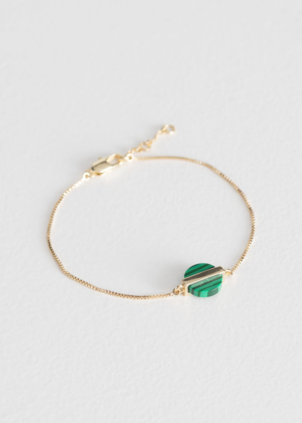 Front image of Stories stone and bar bracelet in green