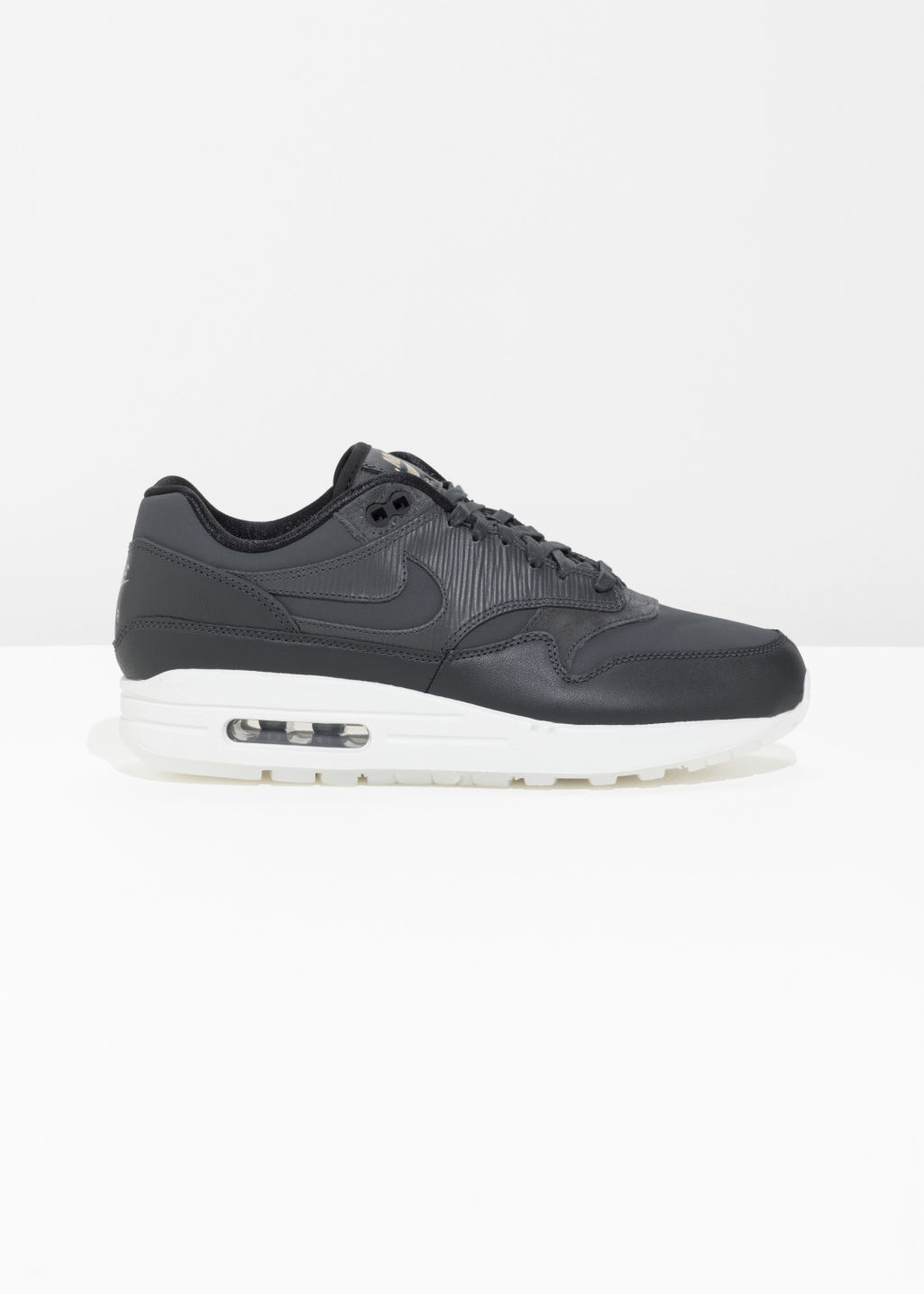 Front image of Stories nike air max 1 prm in black
