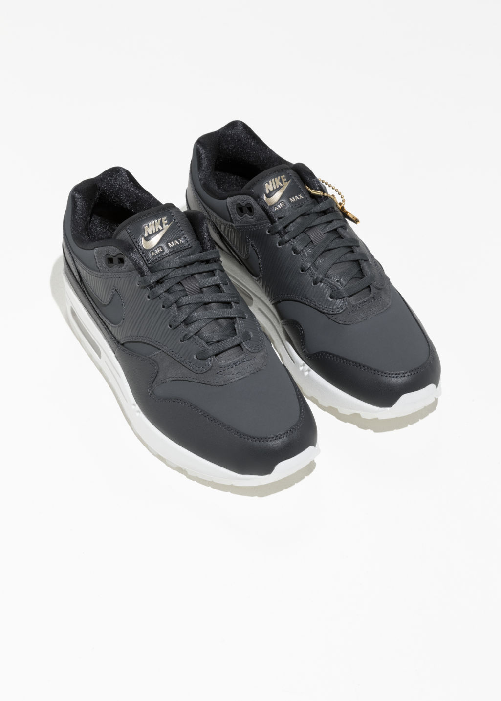 Back image of Stories nike air max 1 prm in black