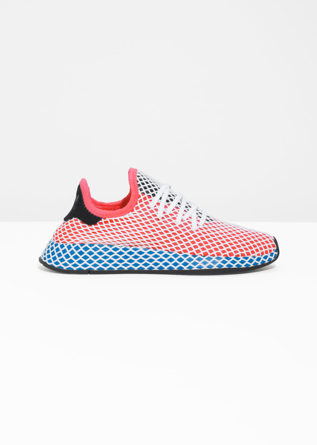 Front image of Stories adidas deerupt runner in red