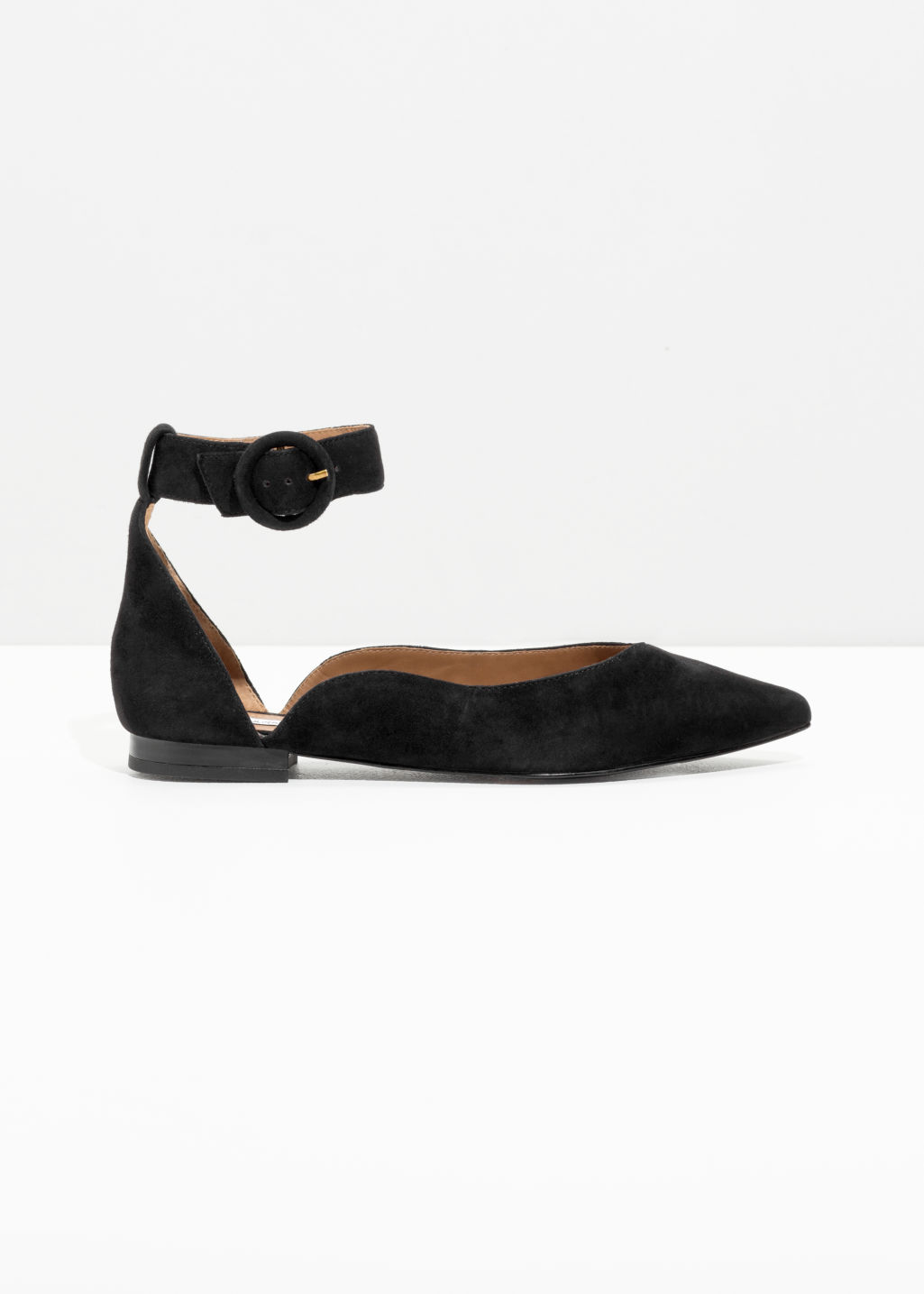 Front image of Stories pointed ankle strap flats in black