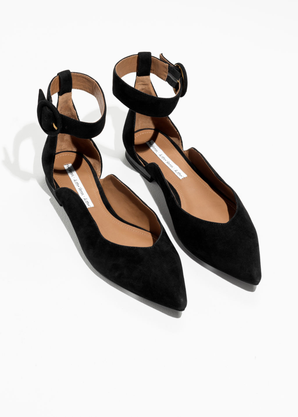 Back image of Stories pointed ankle strap flats in black
