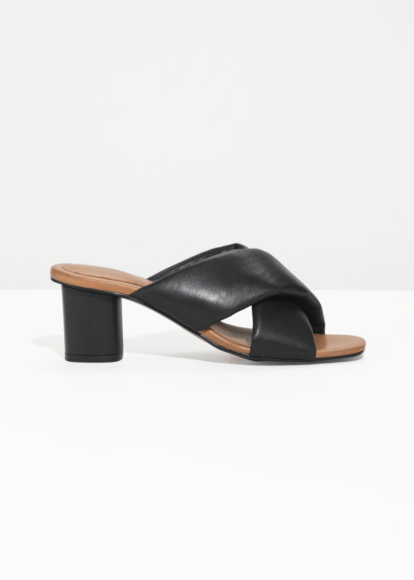 Front image of Stories criss cross heeled sandals in black