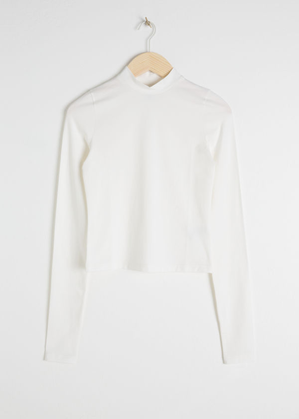Front image of Stories fitted mock neck top in white
