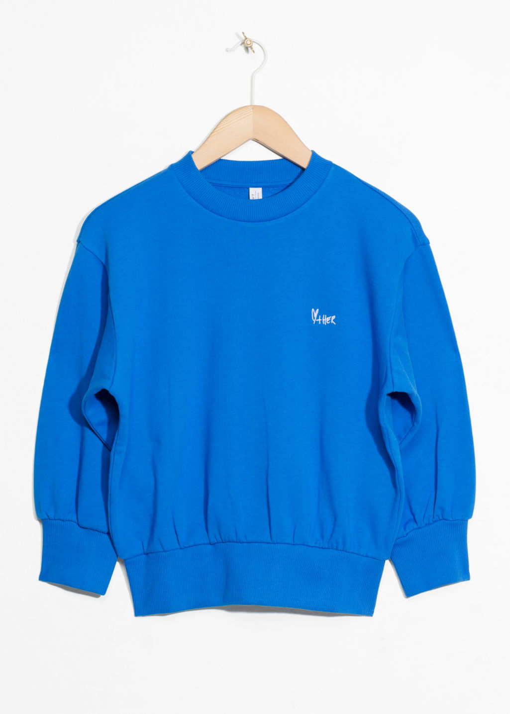 Front image of Stories embroidered cropped pullover in blue
