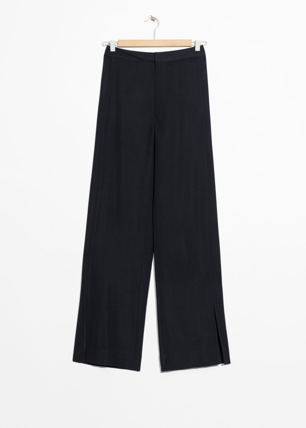 Front image of Stories front slit flare trousers in black