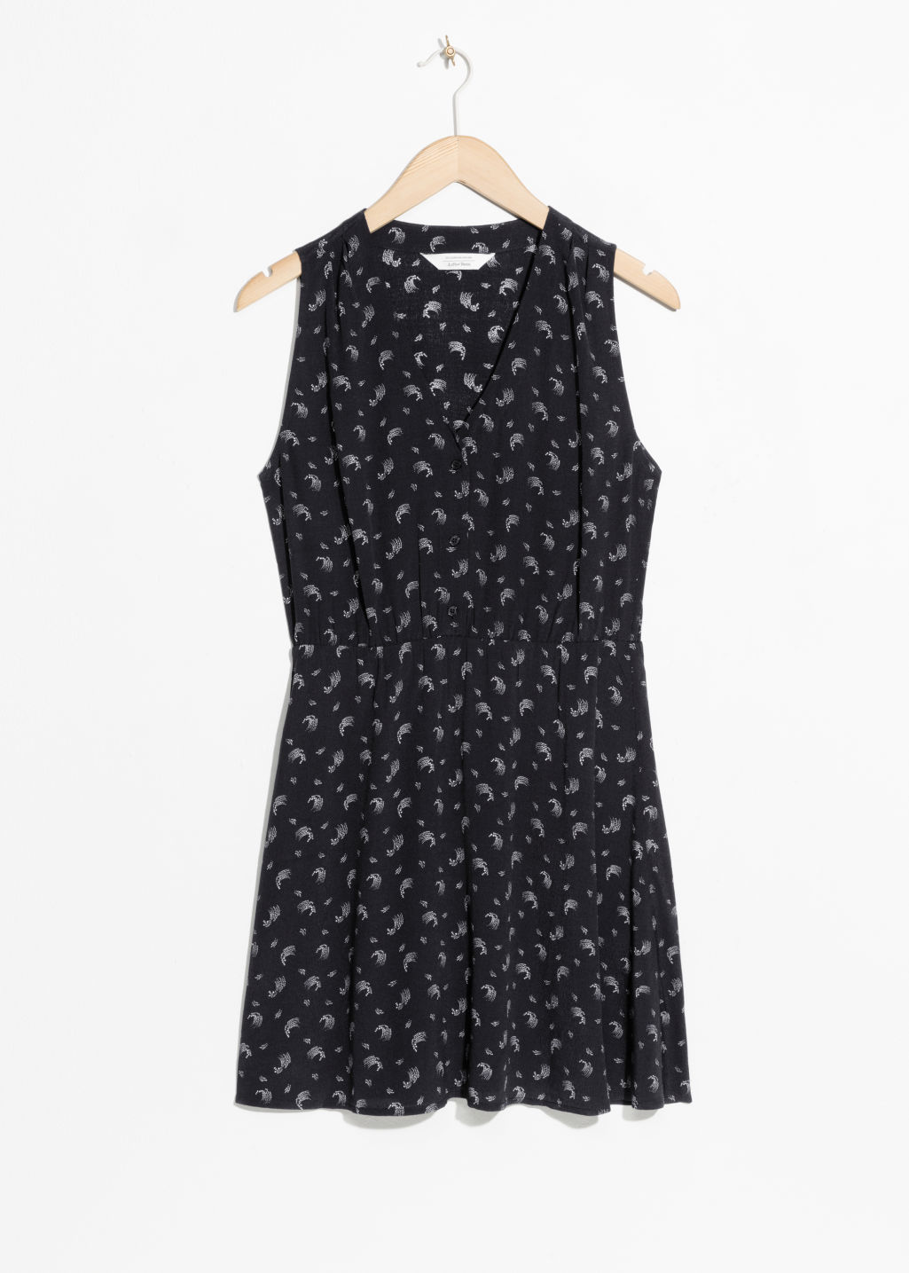 Front image of Stories sleeveless print skater dress in black
