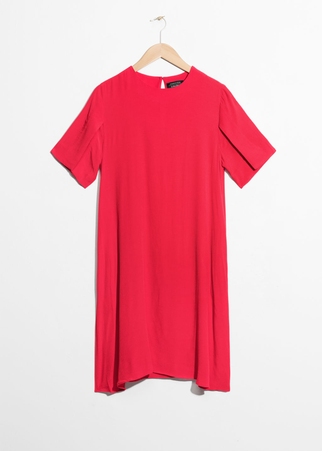Front image of Stories flared sleeve slit dress in red