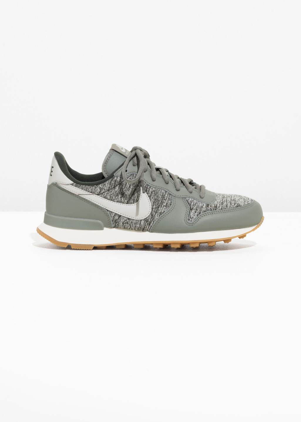 Front image of Stories nike internationalist  in green