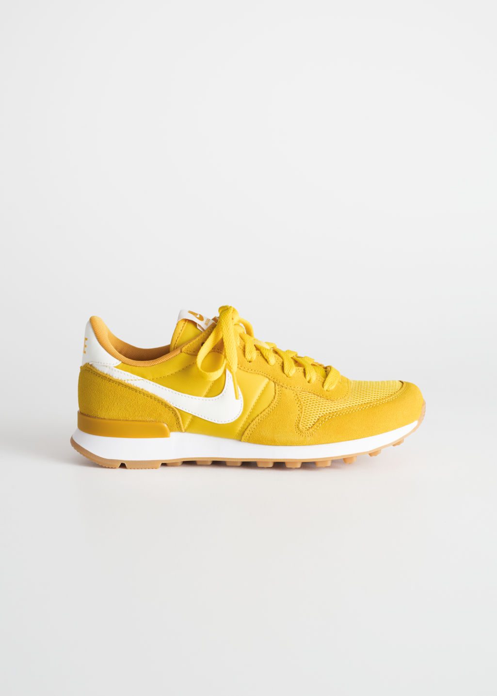 Front image of Stories nike internationalist  in yellow