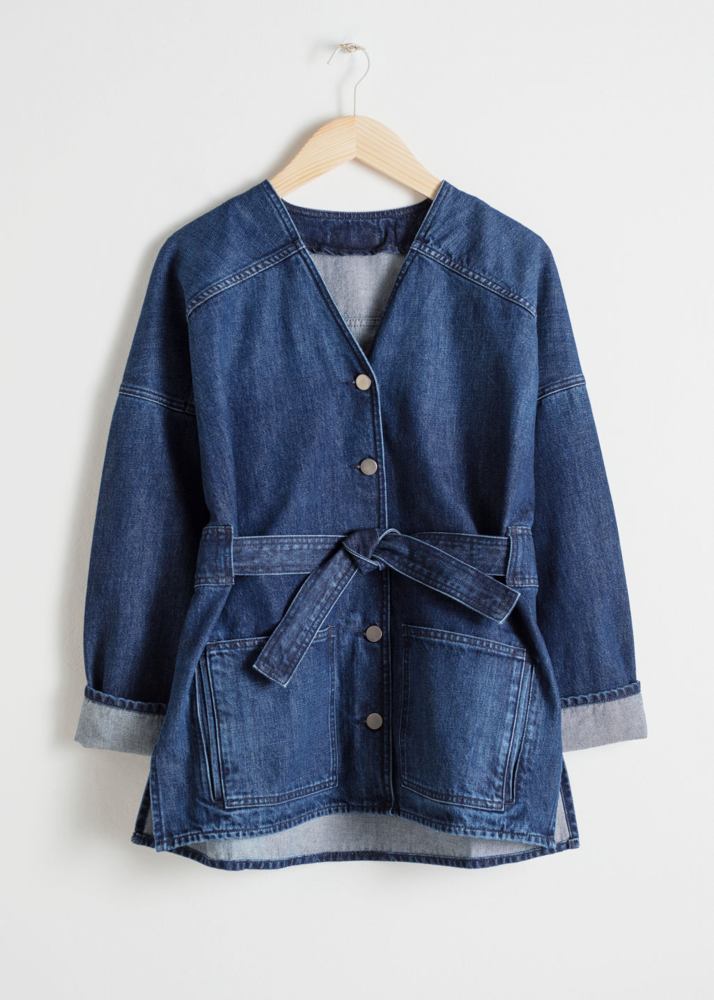 Front image of Stories belted denim jacket in blue