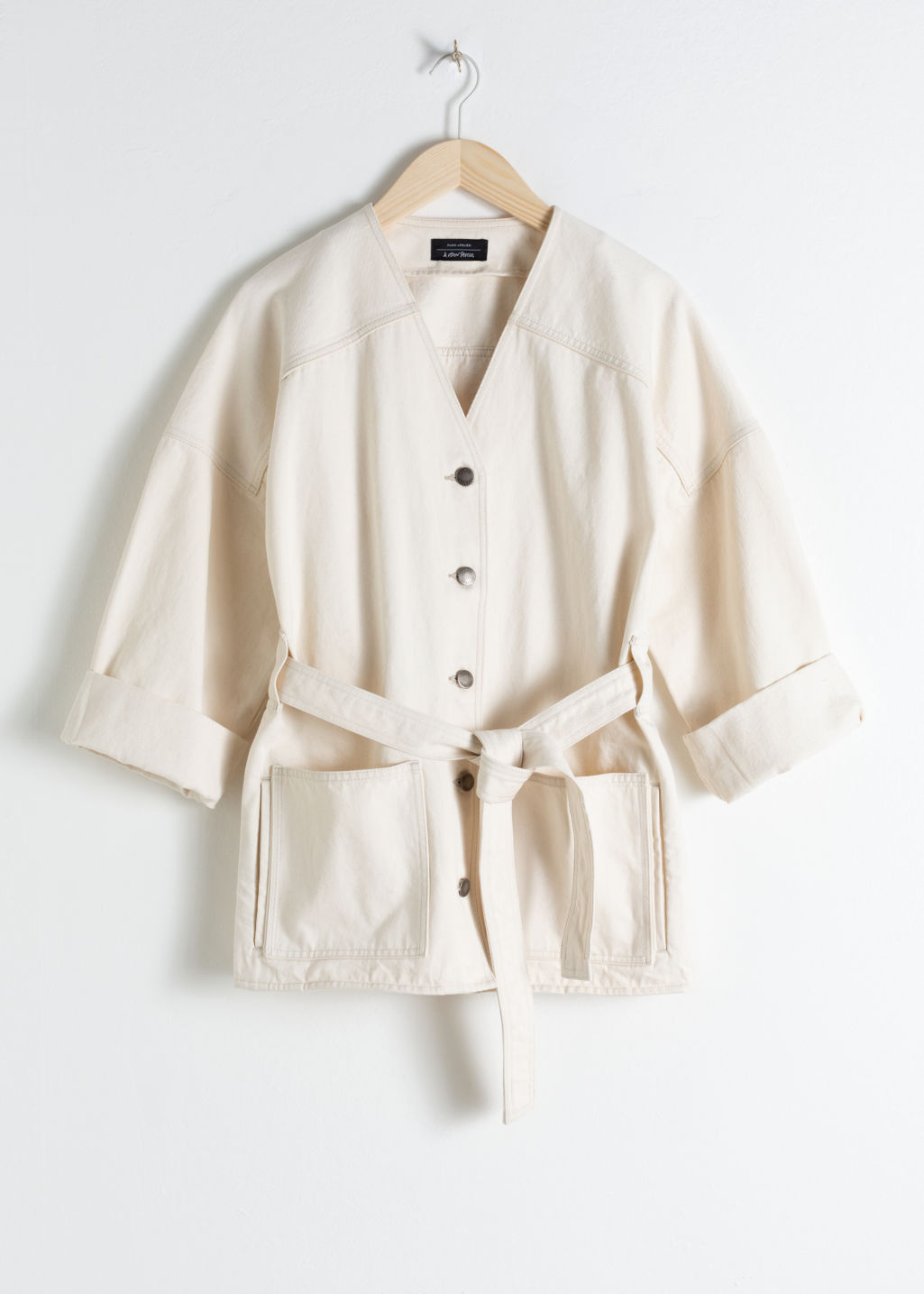 Front image of Stories belted denim jacket in white