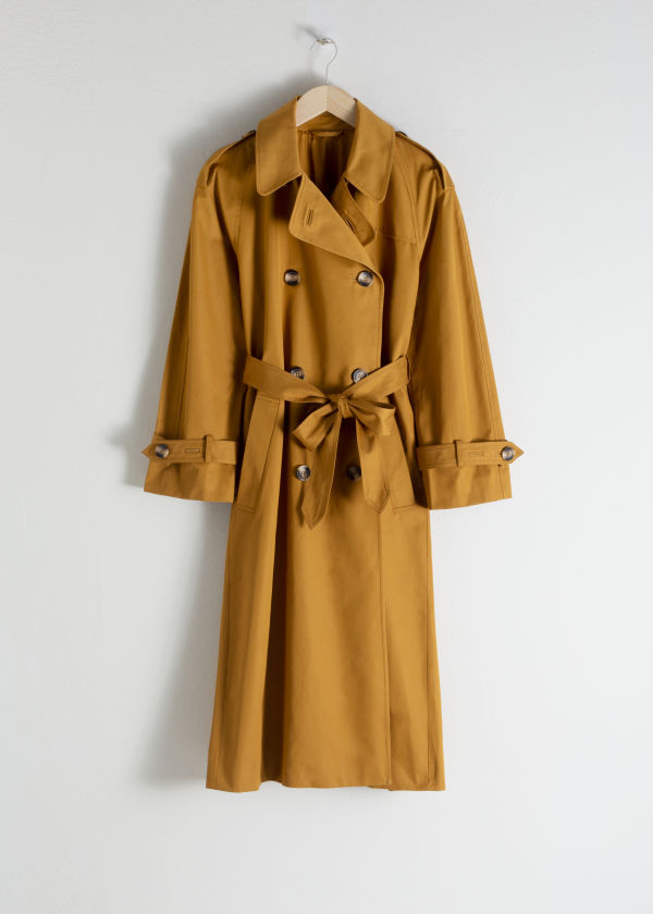 Front image of Stories belted trench coat  in yellow