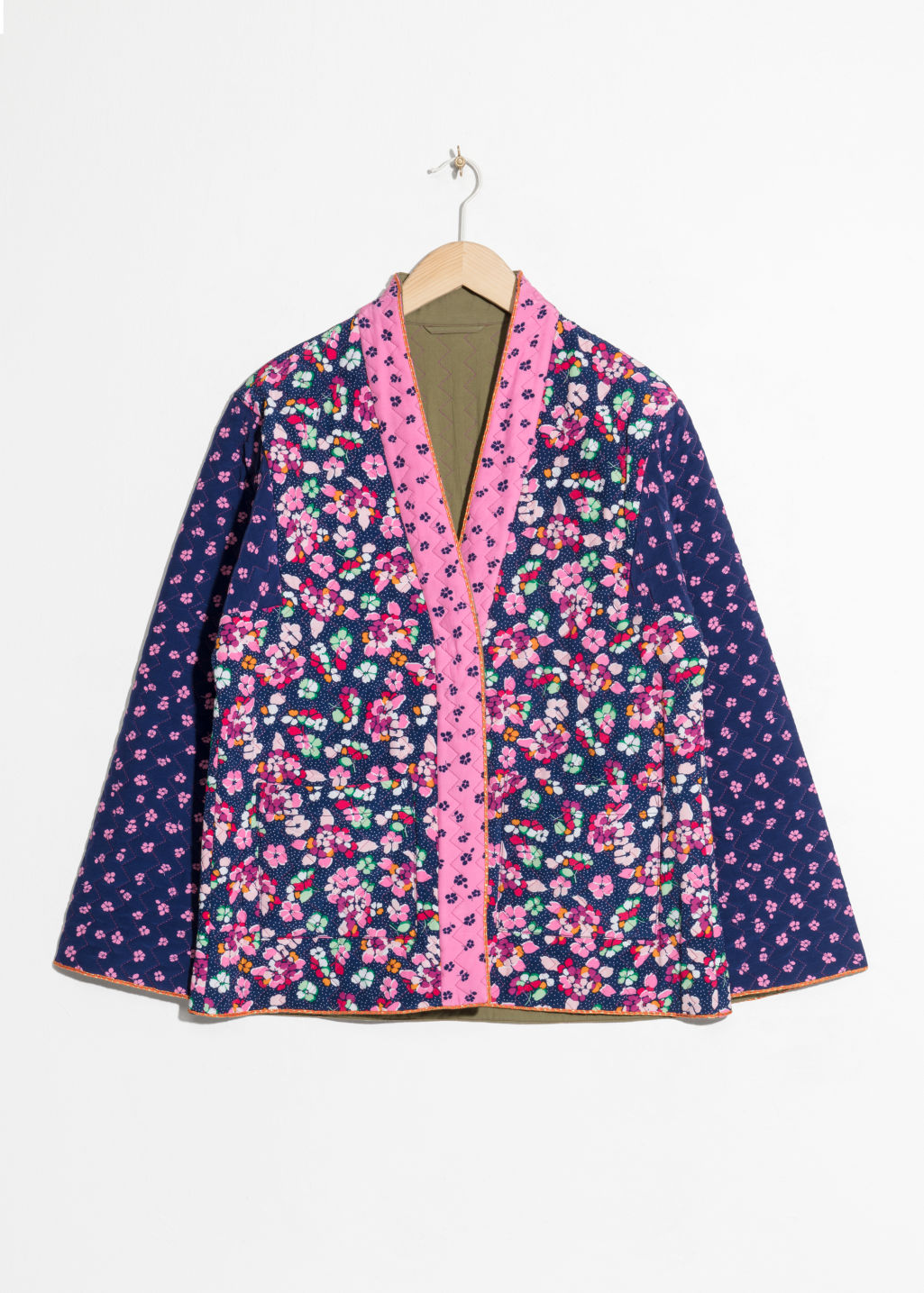 Front image of Stories floral print quilted jacket in blue