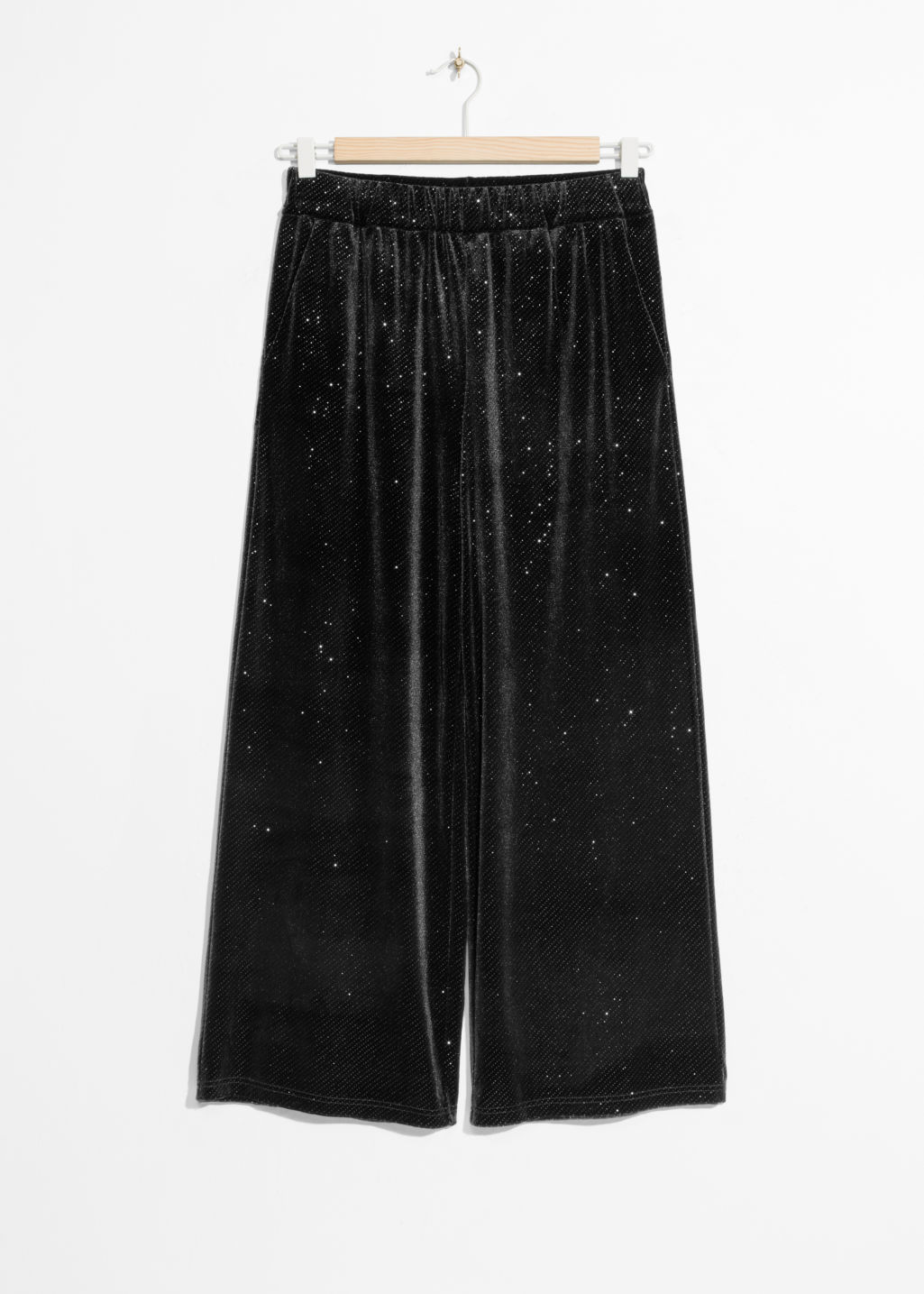 Front image of Stories sparkling velour trousers in black