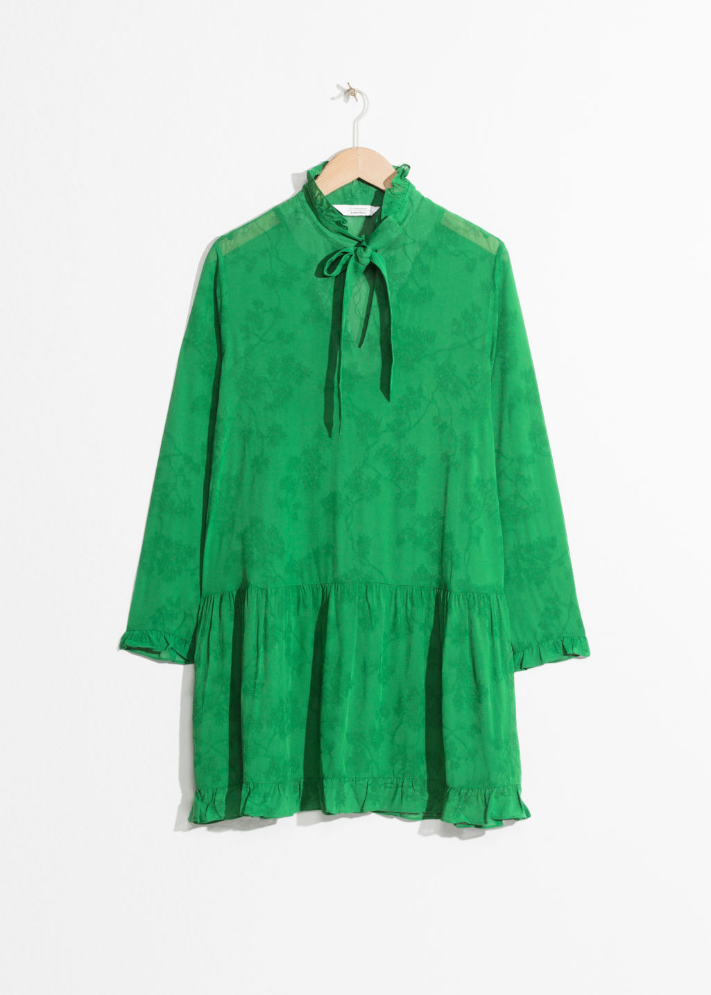 Front image of Stories pussy bow mini dress in green