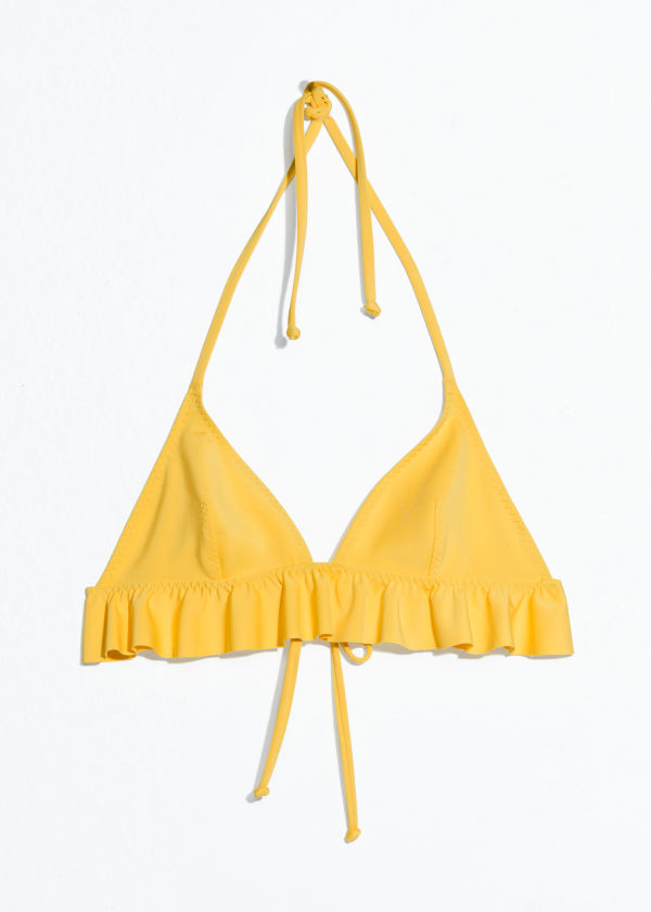 Front image of Stories ruffle halter bikini top in yellow