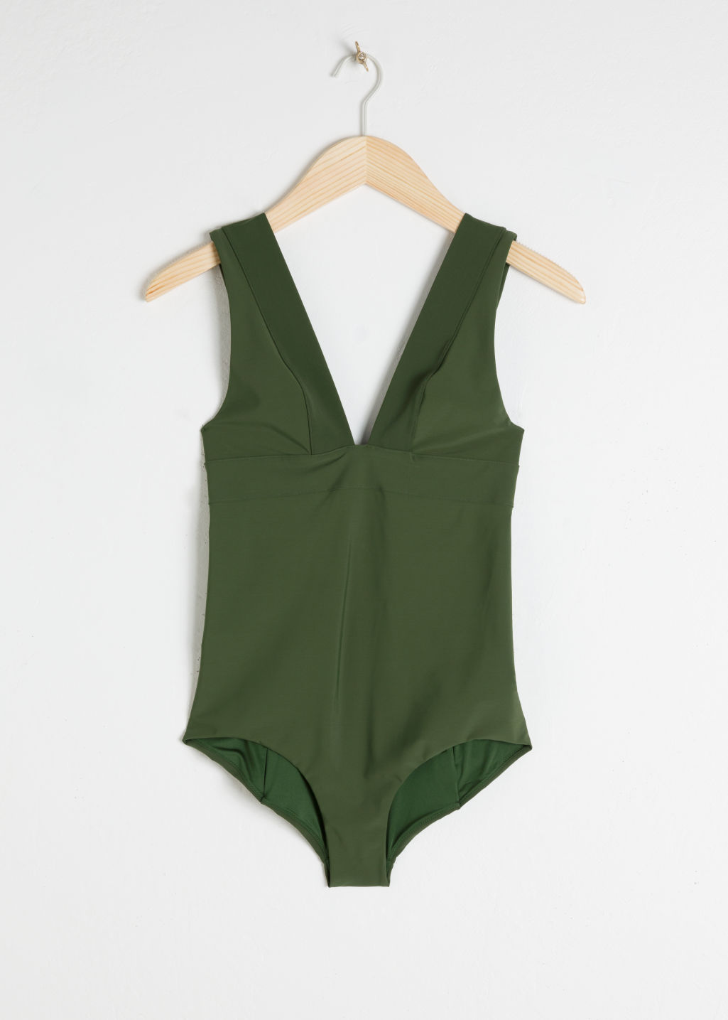 Front image of Stories v-cut swimsuit  in green