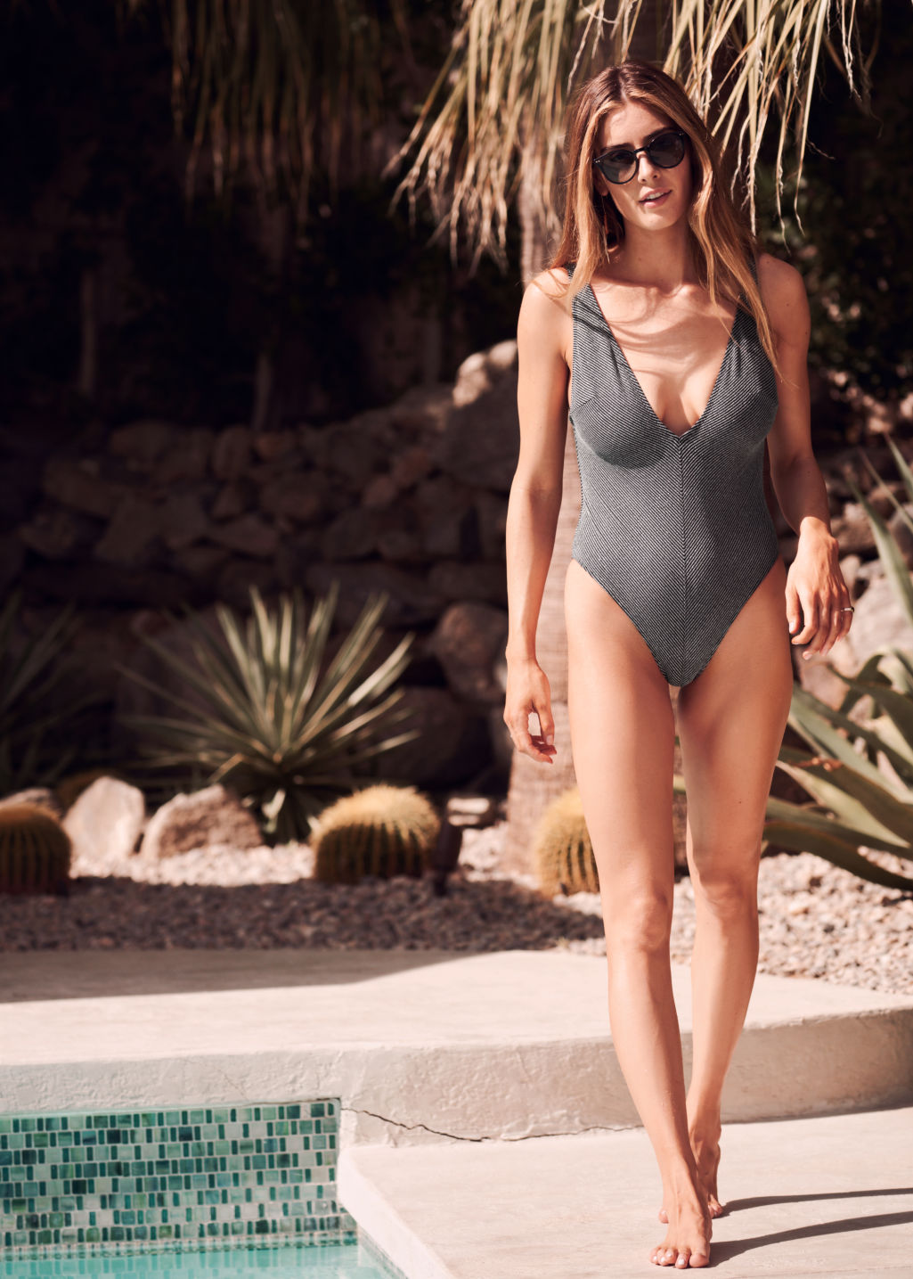Back image of Stories plunging striped swimsuit in black