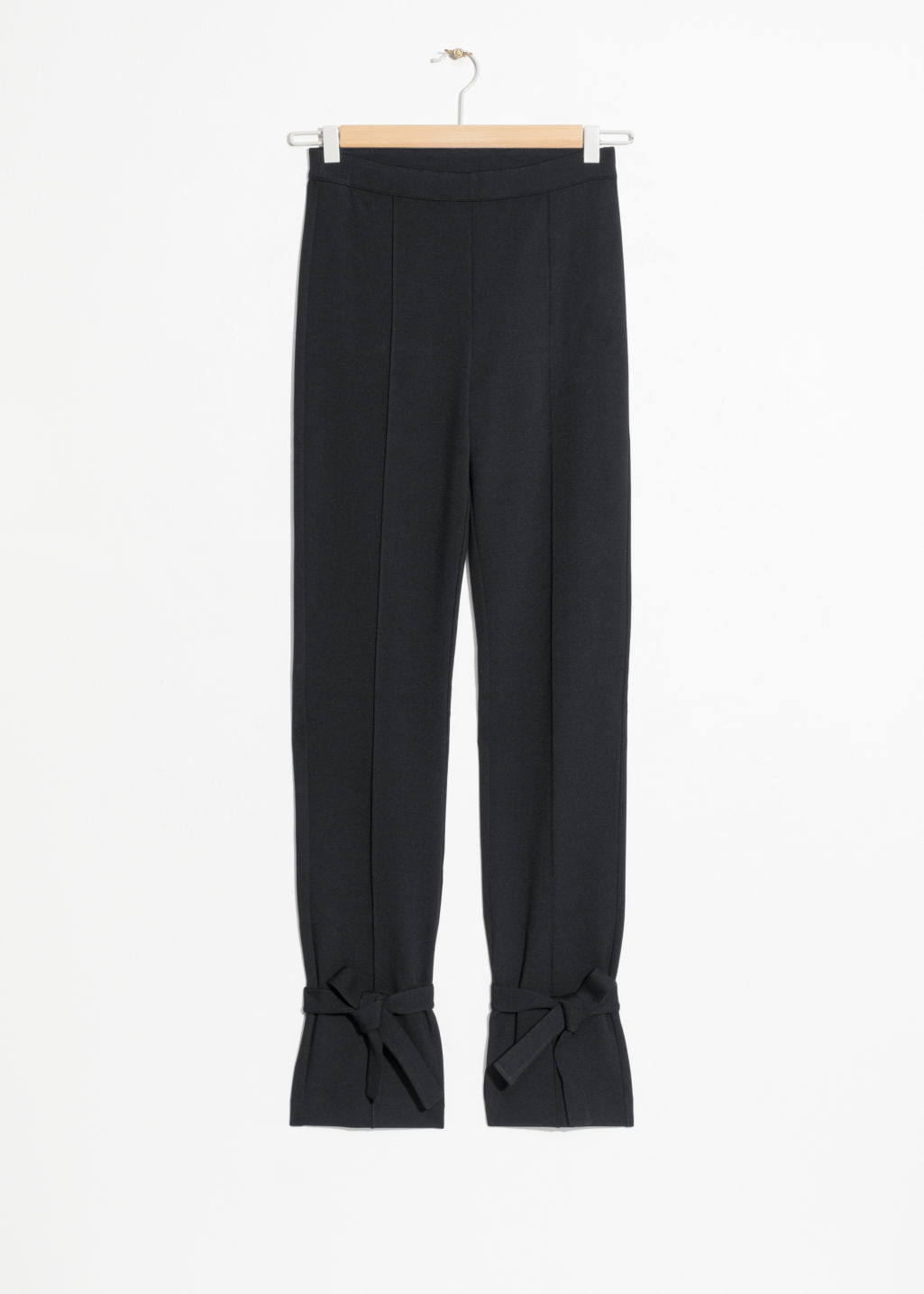 Front image of Stories leg tie trousers  in black