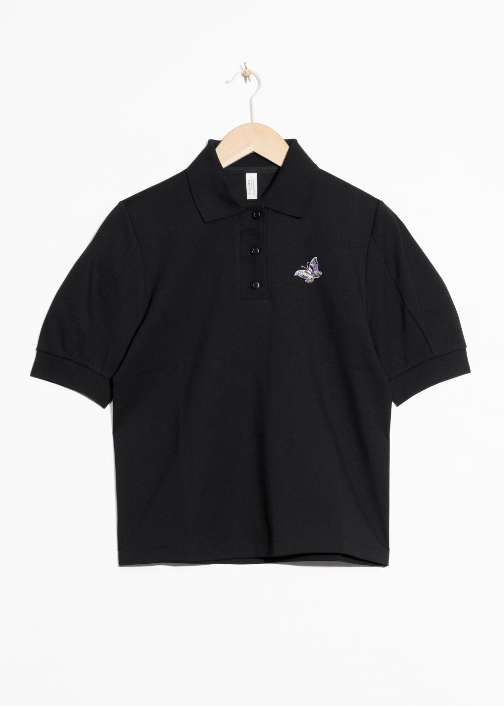 Front image of Stories patch polo shirt in black