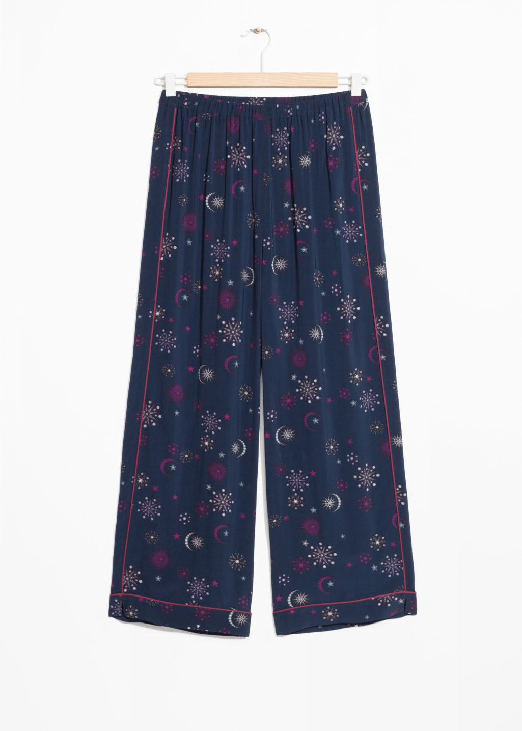 Front image of Stories printed jacquard trousers in blue