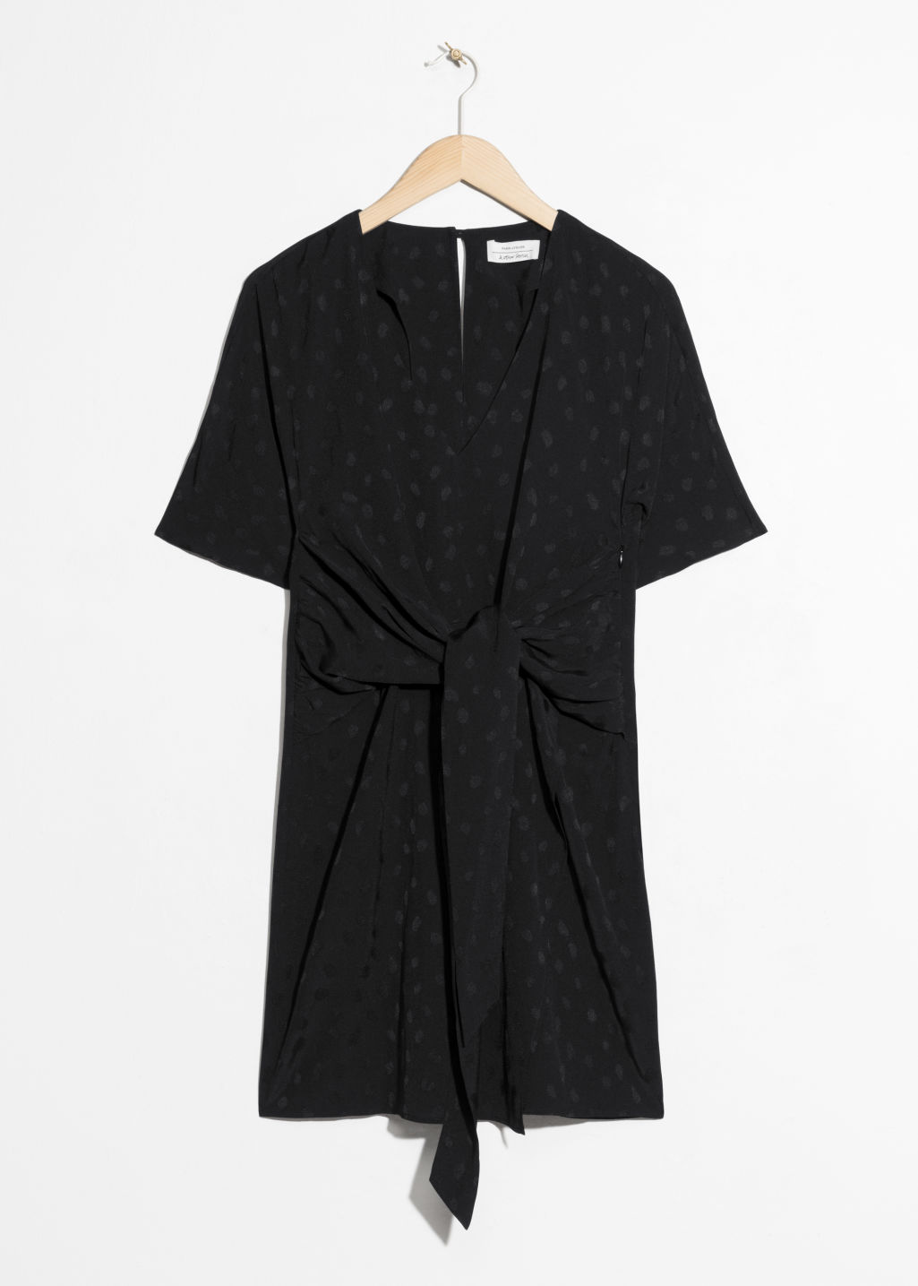 Front image of Stories jacquard twist tie dress in black