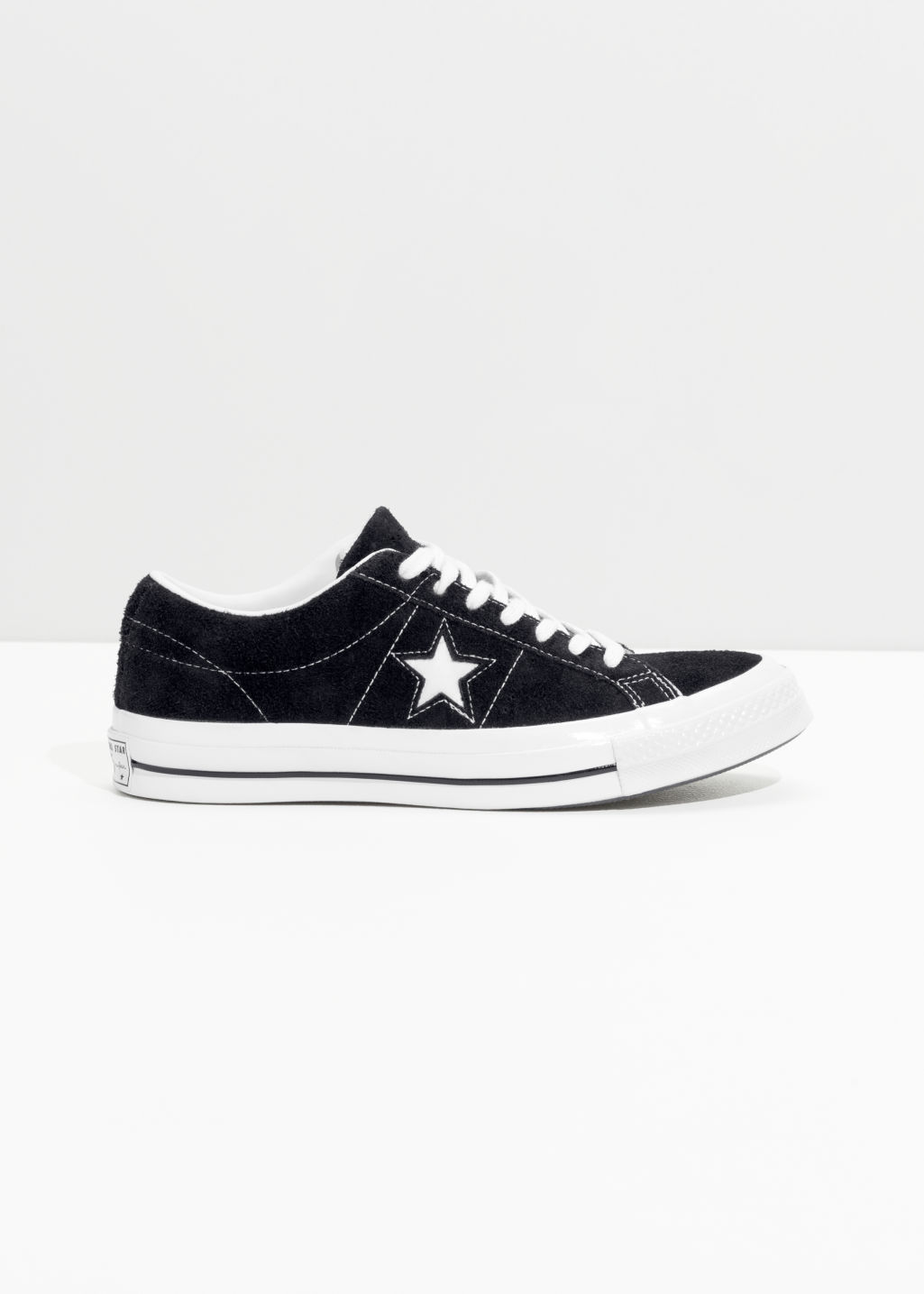 Front image of Stories converse one star- ox in black