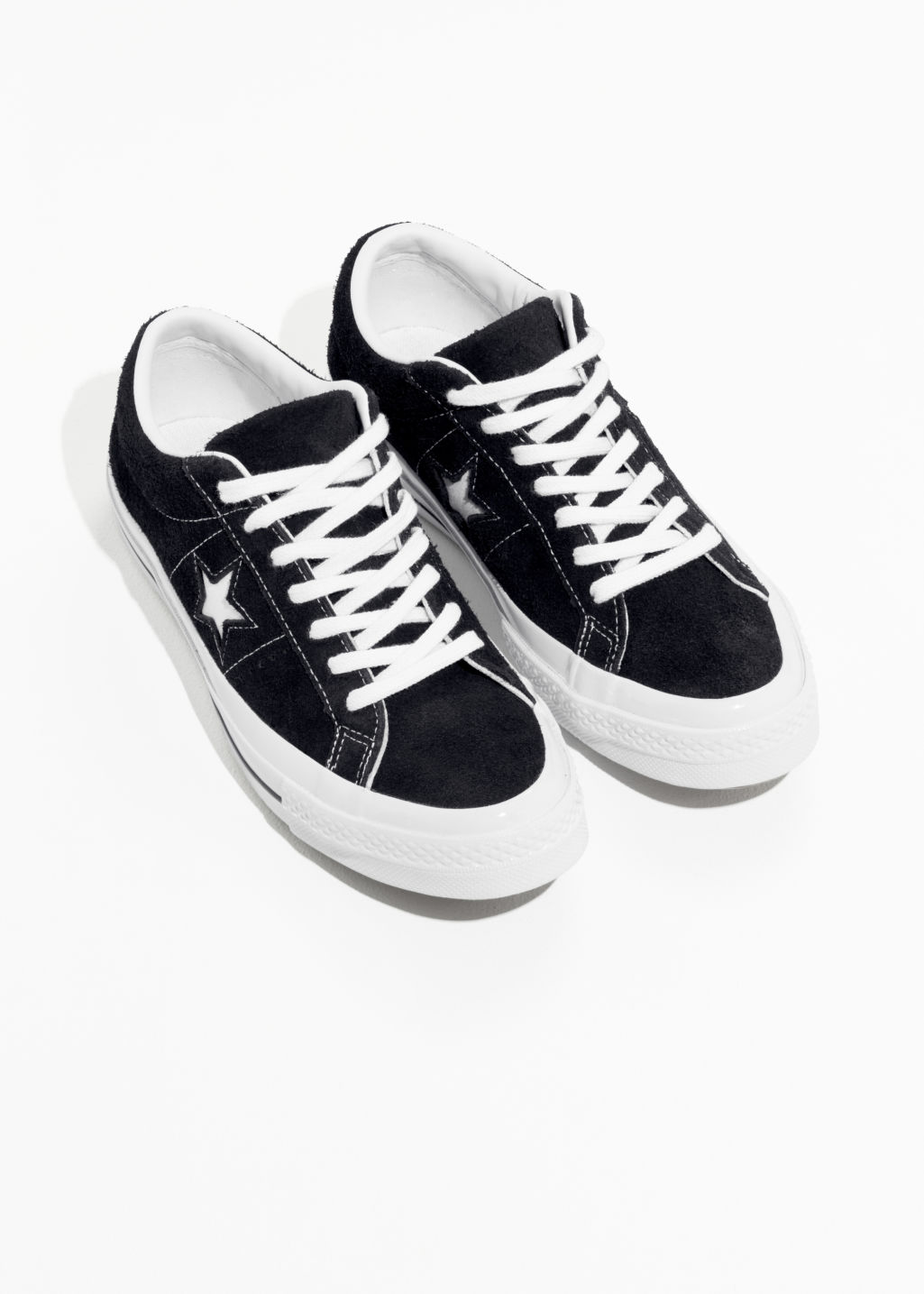 Back image of Stories converse one star- ox in black
