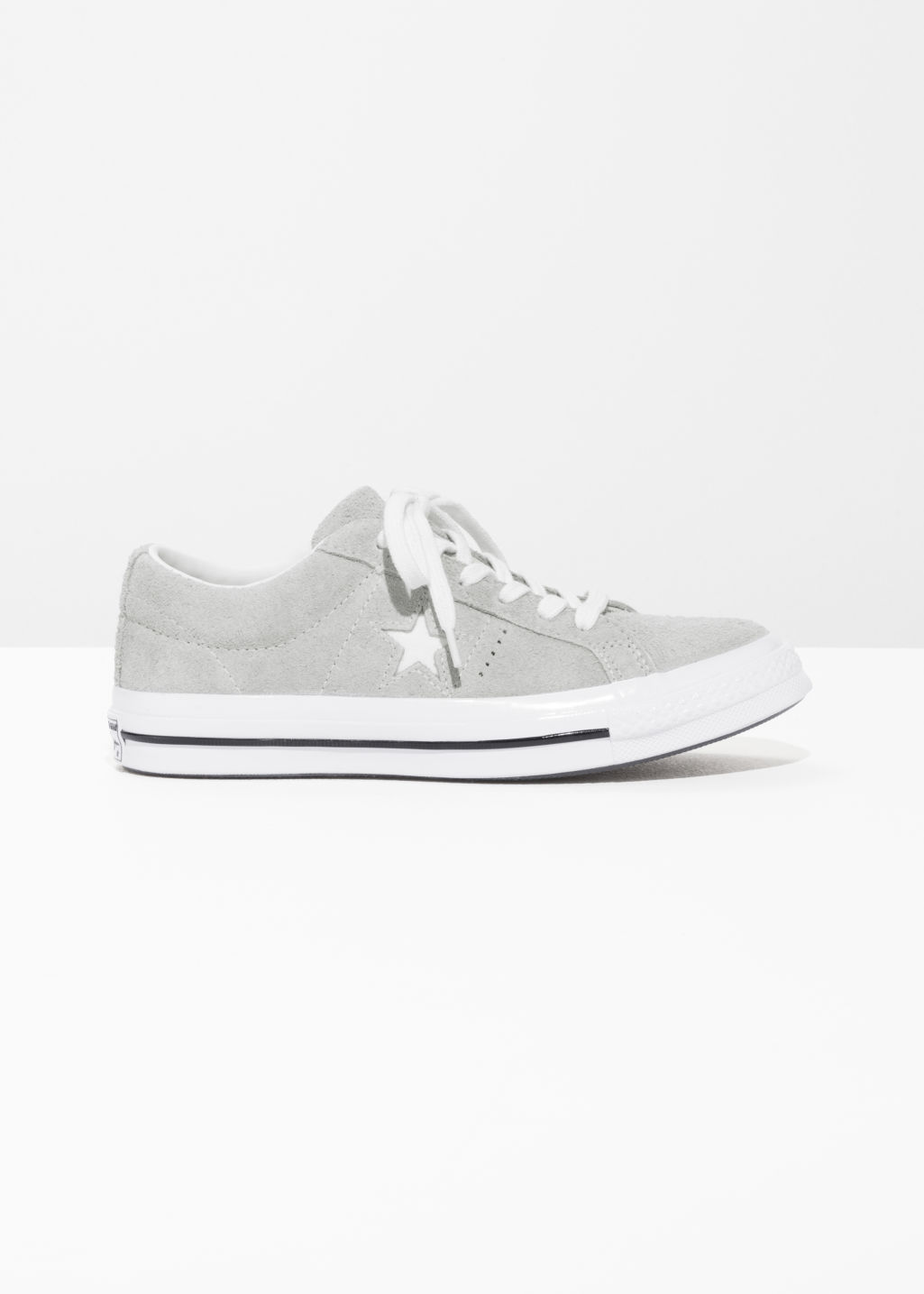 Front image of Stories converse one star- ox in grey