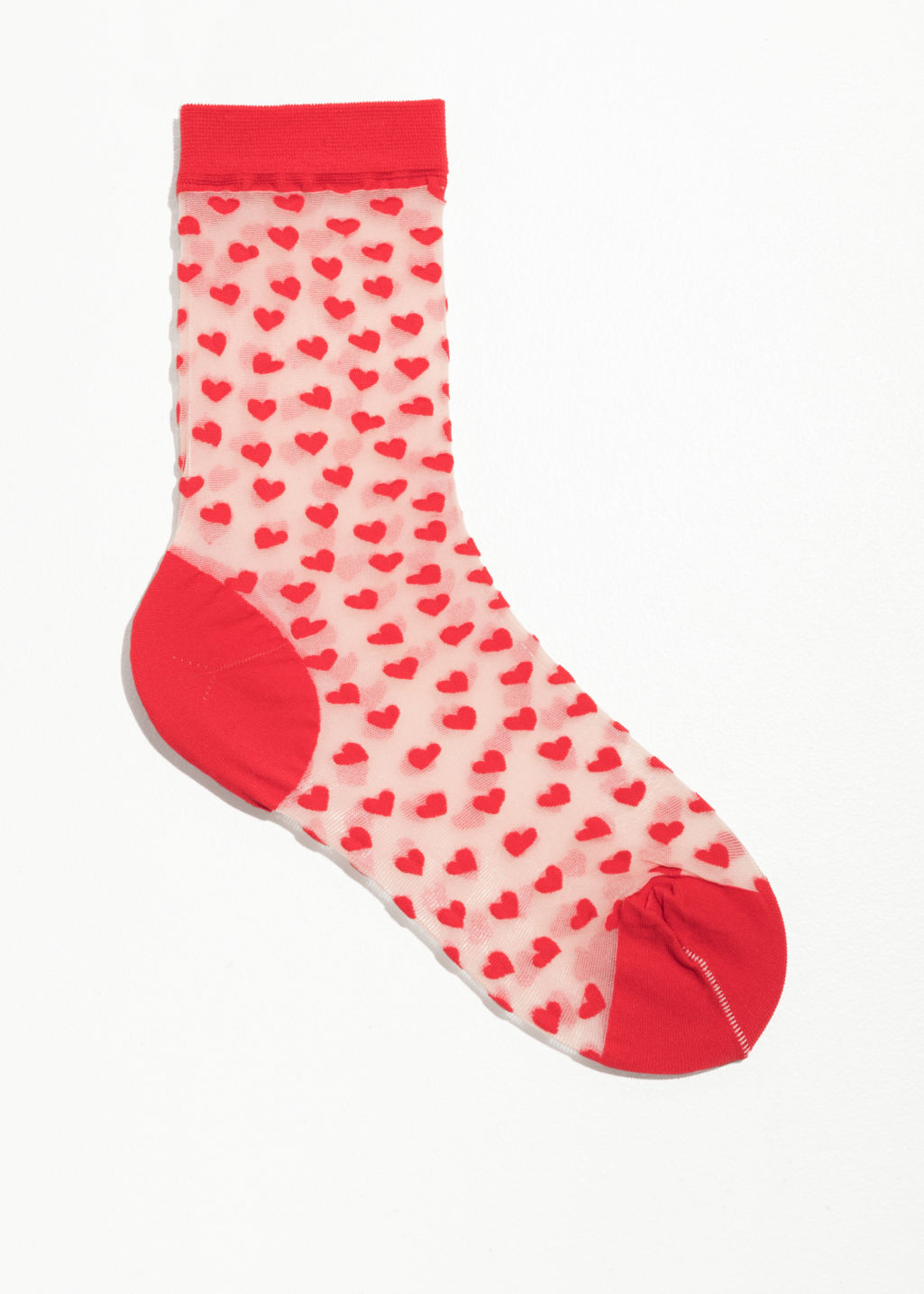 Front image of Stories sheer heart socks in red